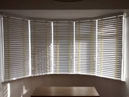 Windows Vertical Blinds - wood venetian blinds in chalk colour fitted to a 5 sectioned bay
