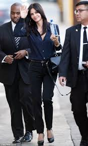 Black Blouse With White Collar Courteney Cox In Navy Blouse With Cigarette Slim Trousers Daily