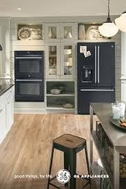 white kitchen cabinets with black slate appliances black slate appliances set light kitchen cabinets