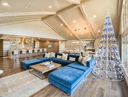 a holiday for everyone oklahoma magazine a pyramid metal tree dressed with blue and silver ornaments complements the blue sofa in