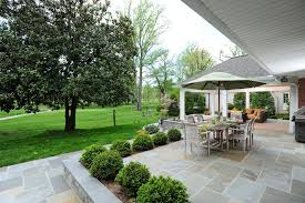 patio bushes patio traditional with teak furniture stone wall