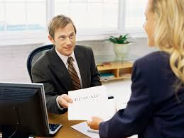 hr objective in resume how to spot an unqualified applicant businessman handing a resume to a businesswoman