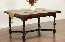 table with slide out leaves sold tudor walnut antique 1910 dining or library table pull out