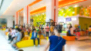 blur or defocus image of people line up to buy movie ticket from