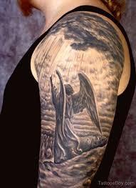 black white flying guardian on shoulder half