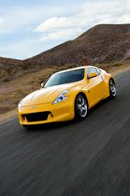 lexus of adelaide certified pre owned yellow nissan 370z which is better upgraded shocks and lowering
