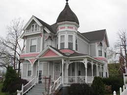 white with pink accents queen anne eastlake victorian house