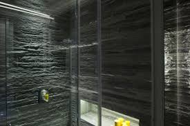 bathroom lighting stone tiles glass walls elegant apartment
