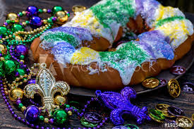 king cake where to buy king cake surrounded by mardi gras decorations buy this stock