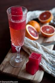bleeding mimosa champagne and blood orange ice cubes