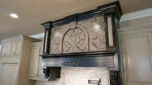 habersham style hand painted cabinets giving this kitchen a unique