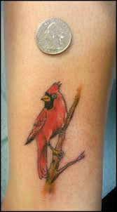 red ink small cardinal bird tattoo