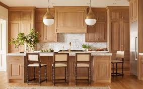 honey oak kitchen cabinets with wood floors honey stained oak kitchen cabinets with brass pendants