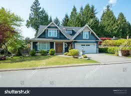 luxury blue house beautiful landscaping on stock photo 305311778