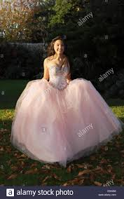 teenage wears a pink princess style prom dress from frock uk