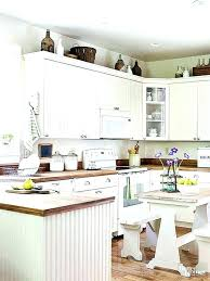 decorating ideas for the top of kitchen cabinets pictures kitchen cabinet decor dbassremovals com
