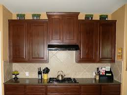 Top Of Kitchen Cabinet Decorating Ideas by How To Decorate The Top Of Your Cabinets An Easy Trick