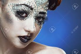 halloween portrait background ideas beauty woman makeup with crystals on face on blue background stock