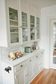 cabinets drawer contemporary farmhouse kitchen design white contemporary farmhouse kitchen design white glass cabinet doors light hardwood floors stainless steel bread toaster glass canisters