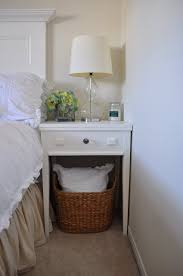 coffee table with baskets under white side table basket underneath to hold an extra pillow or