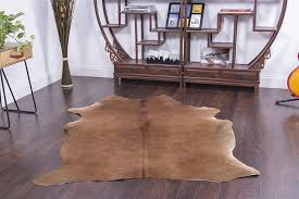 living room cowhide rug decor on pinterest with brown wooden