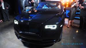 roll royce black the rolls royce black badge wraith is peak selfie magnet slashgear