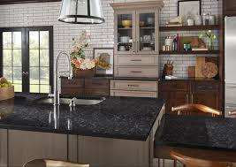 what color goes with oak cabinets pairing quartz countertops with oak cabinets 6 design ideas