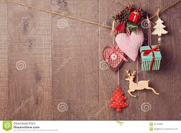 rustic christmas decorations hanging over wooden background with