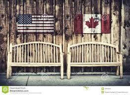 Rustic Log Benches - rustic log benches with canada flag stock image image 52385207