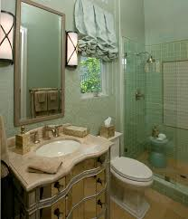 half guest bathroom ideas with gold metal frame wall mirro on blue