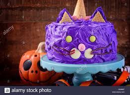 happy halloween cat cake party food with purple frosting and candy