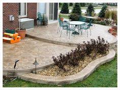 Backyard Concrete Patio Ideas by Love The Stone Surrounding The Concrete Patio Gardening And