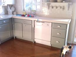 white gray wooden kitchen cabinet with storage and drawers placed