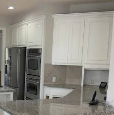 is it better to paint or spray kitchen cabinets 5 tips painting kitchen cabinets white and the