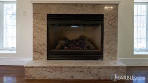 brown granite fireplace surround
