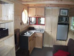 tiny log cabin on a trailer