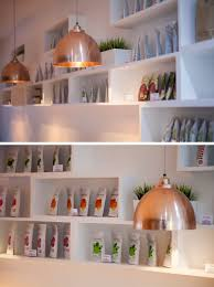 a white grey wood and copper interior was created for this a white grey wood and copper interior was created for this organic restaurant