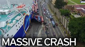 ferry crashes into dock crushing containers and leaving people to