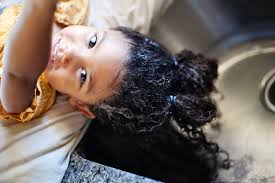 pretty verry young boys washing hairs biracial hair care routine for kids