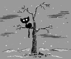 burton cat in dead tree during winter