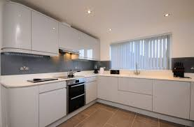 high gloss grey kitchen chartreuse units with built in microwaves