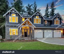 Curb Appeal Usa - luxurious home exterior grey vinyl siding stock photo 564058441