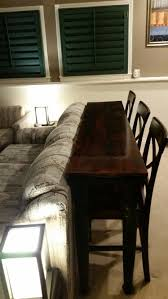 table that goes behind couch sofa table with bar stools wehanghere