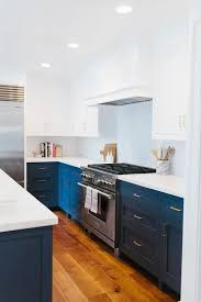 white cabinets on top blue on bottom white and navy blue kitchen features white cabinets