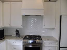 interior artistic fasade backsplash with white kitchen cabinets