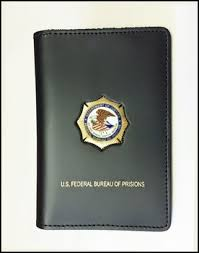 federal bureau of federal bureau of prisons credential with a bop mini badge pin