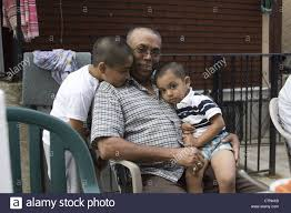 young boys show their affection towards grandpa at a backyard