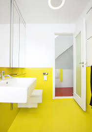 yellow bathroom tiles colors with white fitures golimeco white
