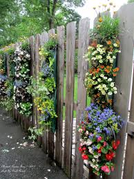 Vertical Flower Bed - hanging bags of flowers make a great vertical impact in the garden
