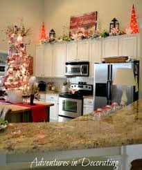 decorating ideas for the top of kitchen cabinets pictures lights and greenery above the kitchen cabinets wreaths hanging